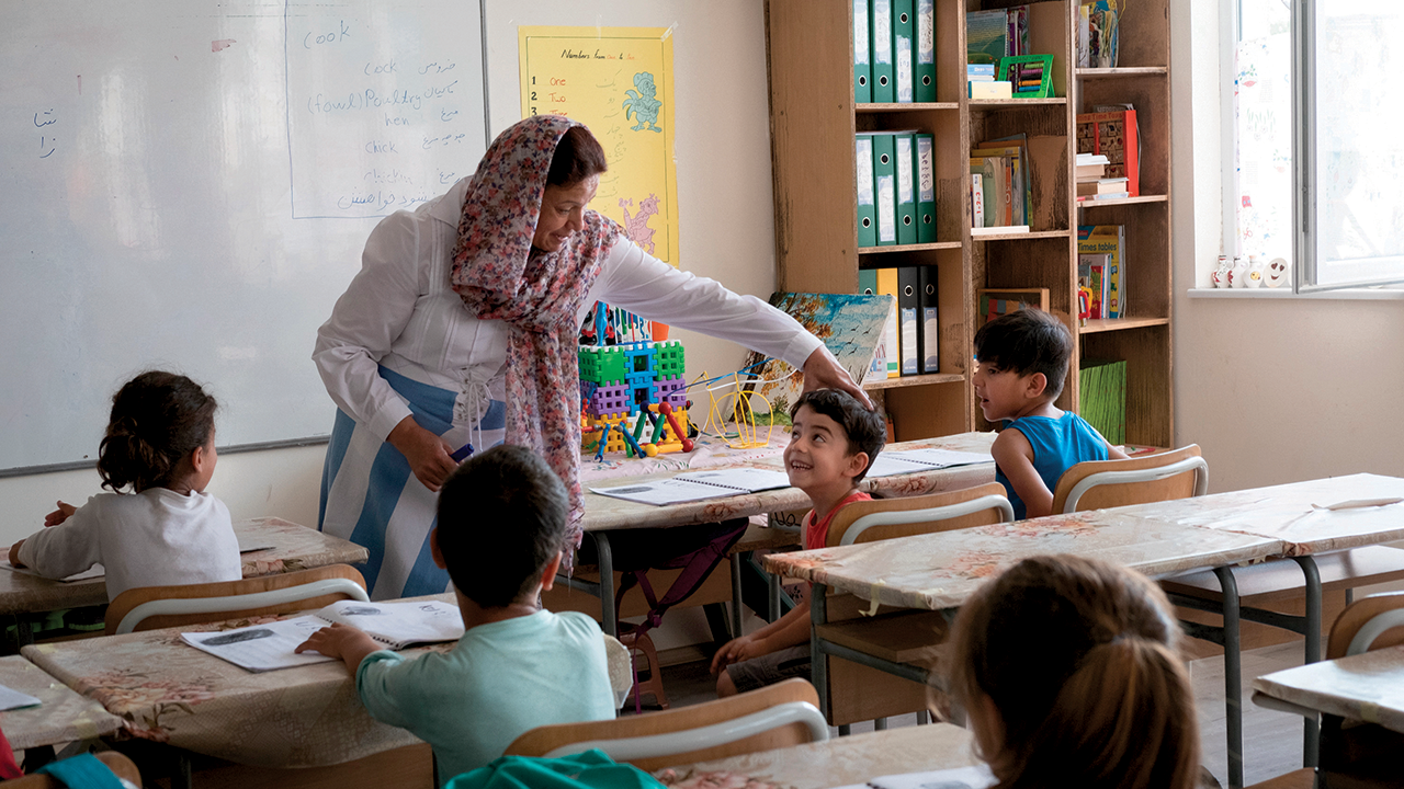 Saleha Naimi, an Afghan refugee, is the director and main instructor at an Afghan school at a refugee center in Harmanli, Bulgaria. In Afghanistan, she was a teacher and school principal.